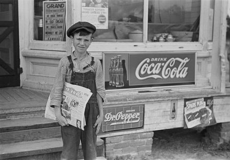 Farm boy who sells Grit. Irwinville Farms, Georgia (John Vachon 1938)