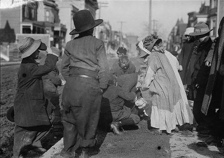 Thanksgiving Maskers scrambling for pennies (1910-1915) Bain News 3