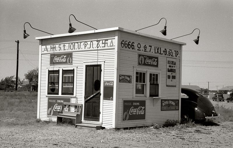 Hamburger stand with old cattle brands. Dumas, Texas Russell Lee 1939
