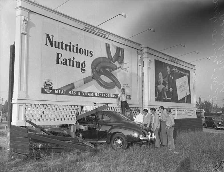 Automobile crash into billboard on Wilshire Blvd. and Mansfield Street in Los Angeles, Calif., circa 1942 1942