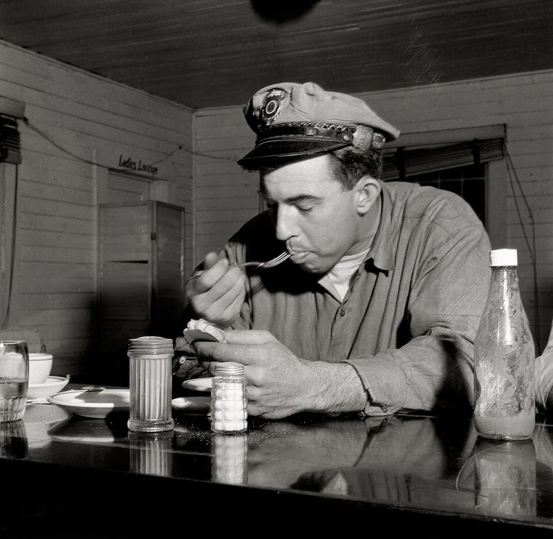 March 1943 Pearlington, Mississippi Truck driver eating at a trucker's stop along U.S. Highway 90 John Vachon