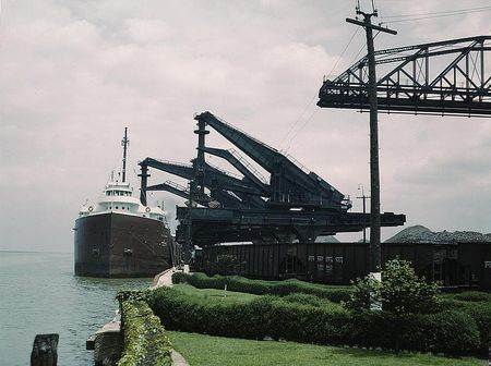 Pennsylvania R.R. [Railroad] ore docks, unloading iron ore from a lake freighter by means of Hulett unloaders, Cleveland, Ohio jack delano 1943