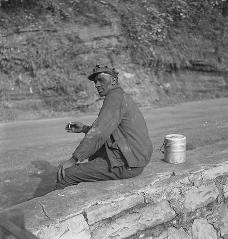 Coal miner waiting for lift home. Capels, West Virginia Marion Post Wolcott (1938)
