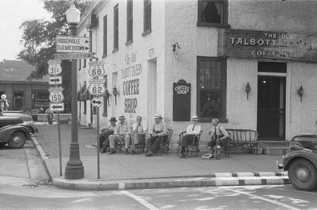 Townspeople visiting while sitting in front of Old Talbott Tavern on Saturday afternoon. Bardstown, Kentucky Marion Post Wolcott 1940