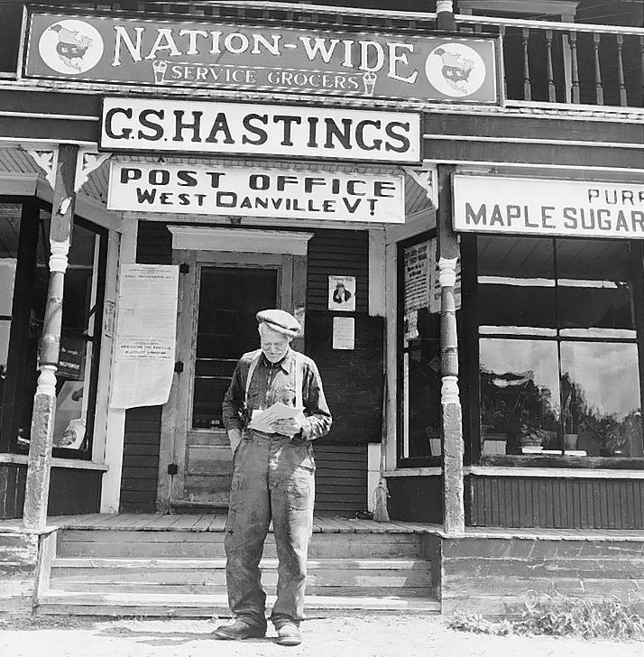 West Danville, Vermont. Frank Goss, seventy-one year old farmer, in front of Gilbert S. Hastings's general store and post office  Frtiz Henle 1942