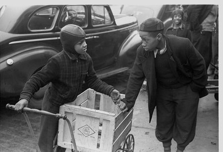 Boys in front of A&P market waiting for jobs to cart home groceries of shoppers, Chicago, Illinois russell lee 1941