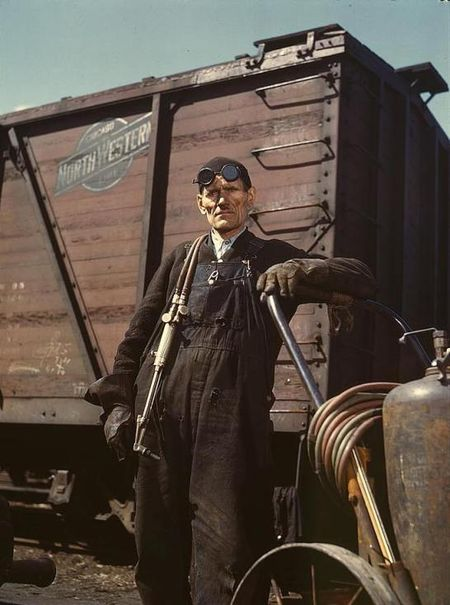 Mike Evans, a welder, at the rip tracks at Proviso yard of the C & NW RR, Chicago, Ill. Jack Delano 1943