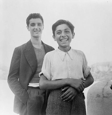 Sicilian boys on a holiday. The people are gradually returning to peacetime enjoyment Nick Parrino owi 1943