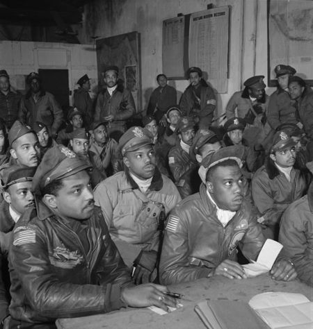 Photograph of several Tuskegee airmen attending a briefing in Ramitelli, Italy, Tony Frissell OWI March 1945