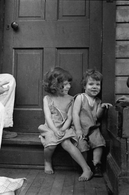 Small girls sitting in doorway of house in Georgetown, Washington, D.C. mydans 1935