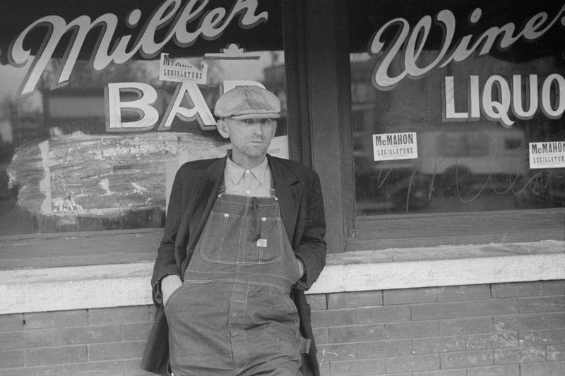 Man in front of saloon in stockyard district, South Omaha, Nebraska John Vachon 1938