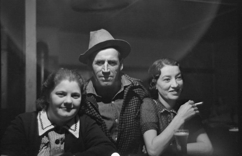 Lumberjack and two attendants in saloon of Craigsville, Minnesota 1937 russell lee