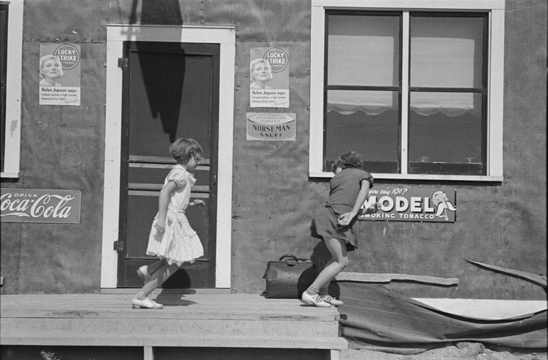Children playing in front of saloon, Gemmel, Minnesota Russell Lee 1937