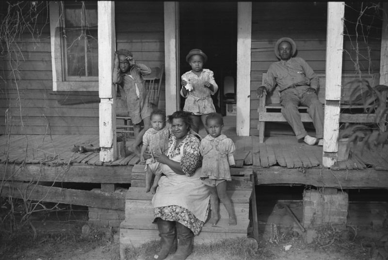 One of tenant families on their porch, Marcella Plantation, Mileston, Mississippi Delta, Mississippi post walcott 1939