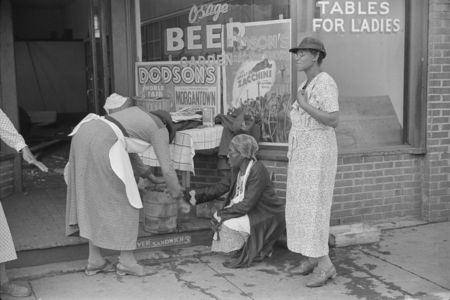 Coal miners' wives making ice cream to sell on Saturday afternoon after payday, Osage, West Virginia post wolcott 1938