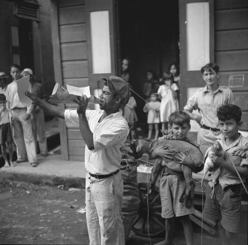 Christmas raffle in the streets of Cidra. The kid and chicken are the prizes. Puerto Rico  Rosskam, Edwin, 1937