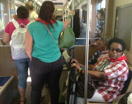 Beaded women on train