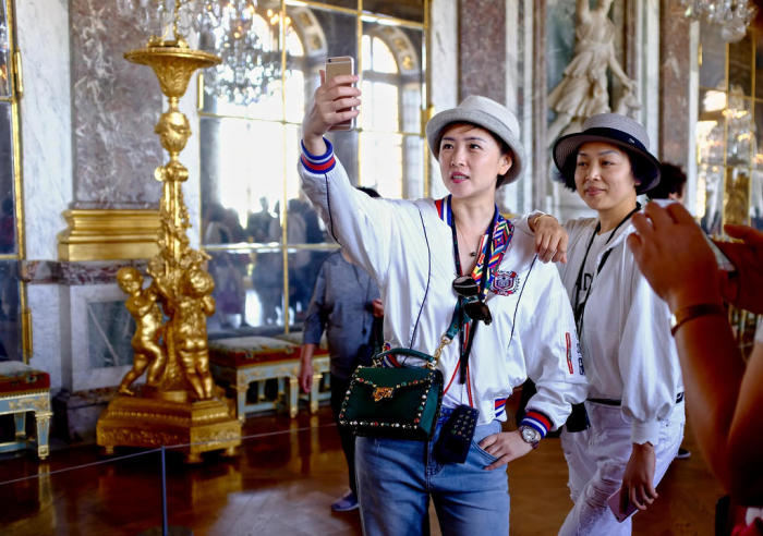 Tourists snapping selfie at Palais de Versailles