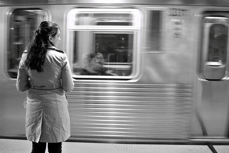 Commuter waiting on Fullterton station platform, Chicago at night