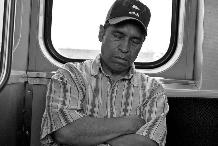 Sunday Sleeper. black and white photo of CTA L Train passenger