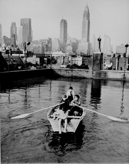 Boys_rowing_a_boat_in_a_rooftop_poo