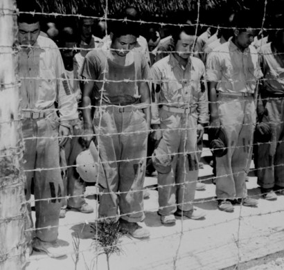 Japanese_pows_at_guam_with_bowed_he